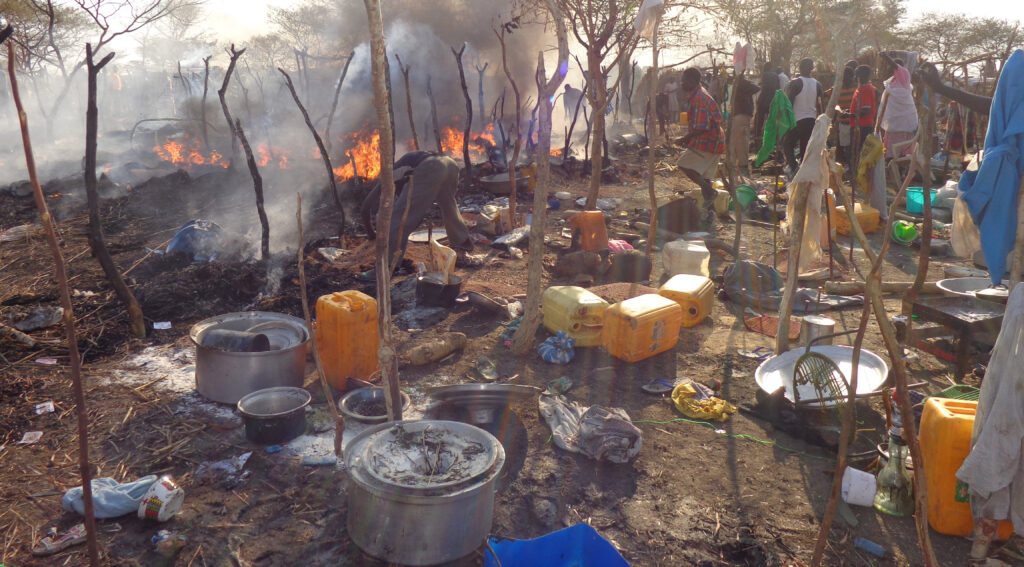 Bentiu IDP site on fire, April 2014. Nonviolent Peaceforce